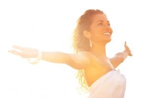 smiling woman in sunlight