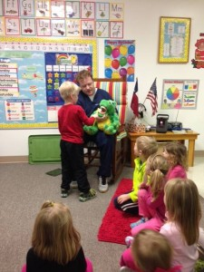 Dr. Thomas visits local schools, helping young children understand good oral hygiene habits.